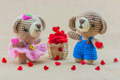 Lovely couple baby bears crochet doll with hearts basket Stock Photo