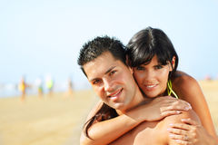 Lovely couple on the beach Stock Images