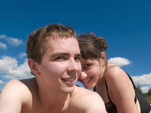 Lovely Couple on Beach. Lovely couple lying on Beach smiling sunny day Stock Images