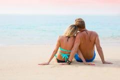 Lovely couple on the beach at sunset. Couple enjoying sunset stock photos
