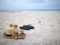 Lovely couple bear with white hat on balcony on white sand beach with Hat at Hua Hin beach, can see riding horse activity, item an royalty free stock image