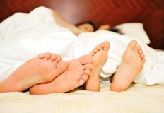 Lovely couple in bed, Royalty Free Stock Photo