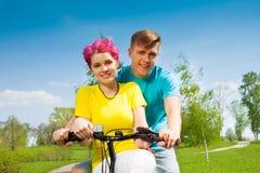 Lovely couple on the bike Stock Image