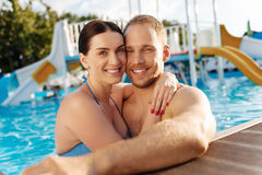 Lovely couple bonding in a swimming pool Stock Photos