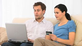 Lovely couple buying something on the internet stock video footage