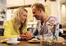 Lovely couple in cafe Royalty Free Stock Images