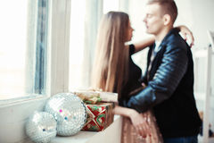 Lovely couple celebrating Christmas eve with present gifts Royalty Free Stock Images
