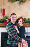 Lovely couple celebrating Christmas together Royalty Free Stock Photos