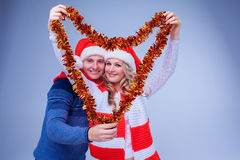 Lovely couple with christmas  garland Stock Photography