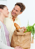 Lovely couple coming back from the market Stock Photos