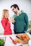 Lovely couple cooking together Royalty Free Stock Photos