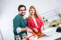 Lovely couple cooking together Royalty Free Stock Image