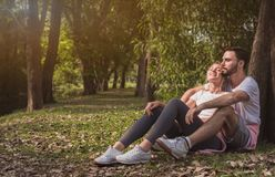 A lovely couple cuddling in a park royalty free stock photos