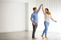 Lovely couple dancing. In new empty flat royalty free stock photography