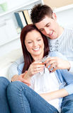 Lovely couple drinking champagne lying on the sofa Royalty Free Stock Photography