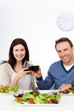 Lovely couple drinking red wine while having lunch Royalty Free Stock Photo