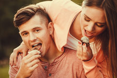 Lovely couple eating cupcakes. Stock Image