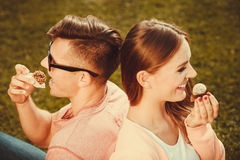 Lovely couple eating cupcakes. Royalty Free Stock Photography