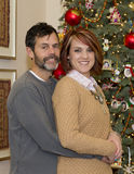 Lovely Couple embracing at Christmas Stock Photography