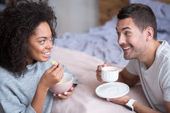 Lovely couple enjoying their honeymoon morning and breakfast Stock Photos