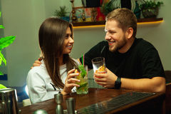 Lovely couple flirting in the bar Royalty Free Stock Image