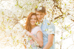 Lovely couple in flower garden Royalty Free Stock Photos