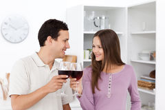 Lovely couple giving a toast with red wine Royalty Free Stock Photography
