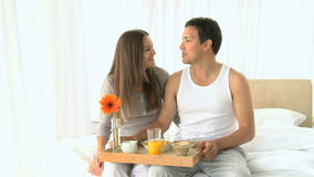 Lovely couple having breakfast in the bedroom Royalty Free Stock Photos
