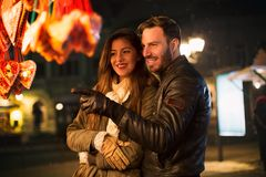 Lovely couple having fun and enjoy at winter night walk Stock Photo