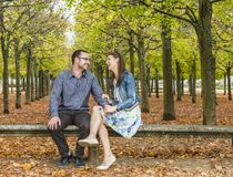 Happy Couple in a Park in Autumn Stock Image