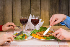 Lovely couple having romantic dinner. Or lunch in restaurant with rustic interior Stock Photos