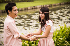 Lovely couple hold the hands in the garden1 Stock Photography