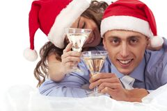 Lovely couple holding the champagne glasses Stock Image