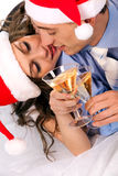 Lovely couple holding the champagne glasses Royalty Free Stock Photos
