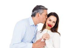 Lovely couple holding flower Royalty Free Stock Image