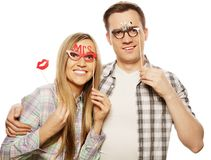 Lovely couple holding party glasses on stick Royalty Free Stock Images