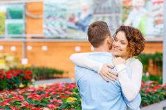 Lovely couple hugging in the greenhouse Royalty Free Stock Photography