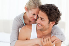 Lovely couple hugging on their bed Stock Images