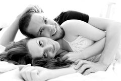 Lovely couple hugging on their bed Stock Image