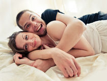Lovely couple hugging on their bed Stock Photos