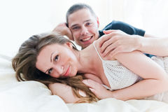 Lovely couple hugging on their bed Stock Photo