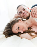Lovely couple hugging on their bed Royalty Free Stock Photos