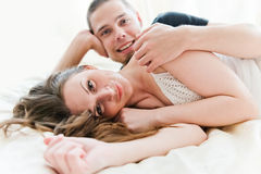Lovely couple hugging on their bed Stock Photography