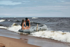 Lovely couple in inflatable boat on lake Stock Photography