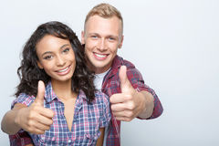 Lovely couple isolated on grey Royalty Free Stock Photography