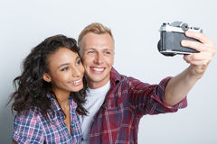 Lovely couple isolated on grey Stock Photography