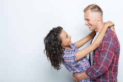 Lovely couple isolated on grey Stock Photos