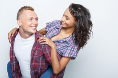 Lovely couple isolated on grey Royalty Free Stock Image