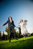 Lovely couple jump in park Stock Images