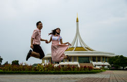 Lovely couple jump up together2 Royalty Free Stock Photos